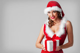 Woman in santa hat with gift