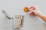 hand throwing website cookie going into a trash can - 227470065