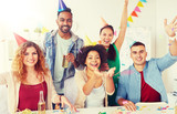 corporate, celebration and holidays concept - happy team with confetti and serpentine having fun at office party - 227478005