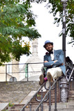 Man staying on a ramp in Montmartre