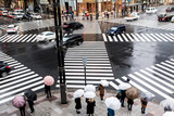 People waiting for crossing at ginza Intersection in tokyo, japan