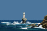 The Tourlitis Lighthouse In Andros Island Cyclades Greece during a windy day with big waves - 227511874