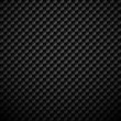 Black carbon textured background with fiber weave structure.