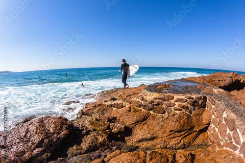 Fototapeta Surfers Rocks Going Surfing Ocean Entry Jump