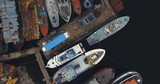 Aerial birdview over old colorful boatyard outside the swedish east coast. - 227528620
