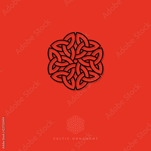 Celtic ornament. Rosette pattern, interlaced lines in a floral motif, isolated on a dark background. Black lines ornament. Monochrome option. © Nataly