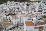 Array of white houses on the mountainside