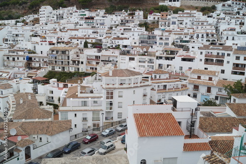Array of white houses on the mountainside - 227535401