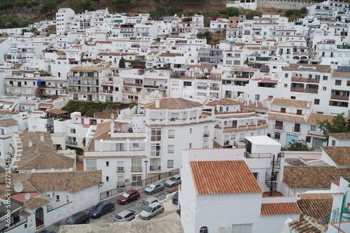 Fridge magnet Array of white houses on the mountainside
