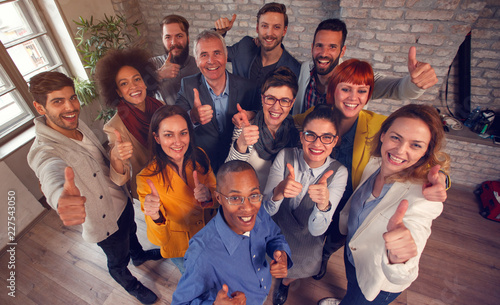 Poster Group of success business team giving thumbs up.