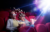 Romantic couple cuddling and watching the miraculous part of the film - 227569846
