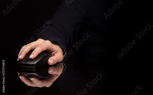 Hand using wireless mouse in a dark environment  - 227576824