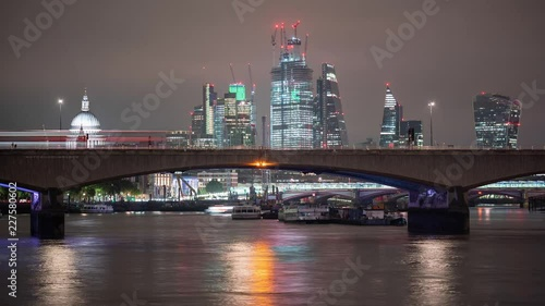 Time-lapse of traffic on Waterloo Bridge and London skyline in the background.