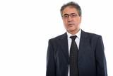 Studio shot of senior Persian businessman wearing eyeglasses - 227588078