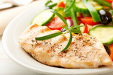 Grilled chicken breast with green and red pepper, cherry tomatoes, lettuce, black olives, cucumber, pink pepper and fresh rosemary. Home made food. Concept for a tasty and healthy meal. Close up. - 227593290