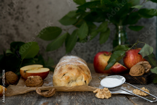 Apple classic strudel on a wooden table - 227601206