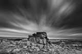 Stunning Autumn sunset landscape image of view from Leather Tor in Dartmoor National Park in black and white