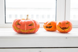 Halloween Pumpkins. Funny Jack O'Lantern on the light room - 227610228