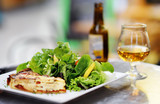 Traditional French food: quiche lorraine and fresh salad leaves with glass of beer on background - 227615491