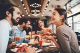 Group of Happy friends having breakfast in the restaurant - 227620829