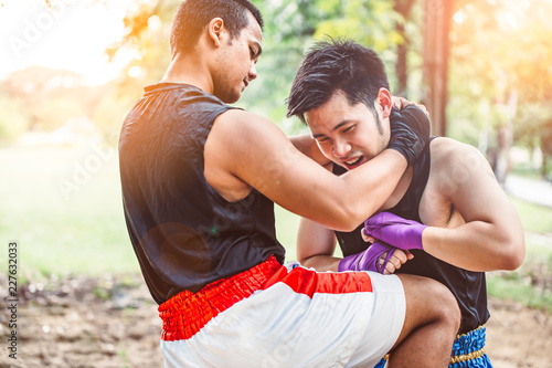 Muay thai martial art or Thai boxing,Two young kickbox fighters training in the park