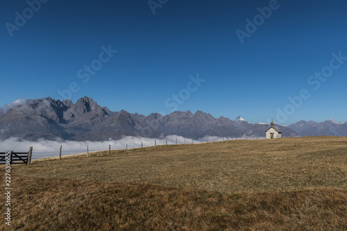 Wonderful Autumn Mountain Panorama Landscape View With Antonius Chapel And Grossglockner In Background