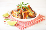 Teriyaki chicken wings. Baked chicken  with fresh rosemary. Homemade food. Symbolic image. Concept for a tasty and healty dish. Bright wooden background. Copy space. - 227664605