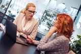 Business women in modern office - 227667822