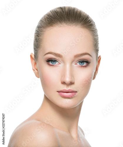 Leinwandbild Motiv Beautiful face of young woman