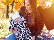 Family with a baby girl in the autumn Park
