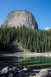 Big Beehive, a famous rock formation in the Canadian Rockies, looms over Mirror Lake, on the Lake Agnes Teahouse trail at Lake Louise in Banff National Park