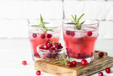 Cocktail with cranberry, vodka, rosemary and ice. - 227689894