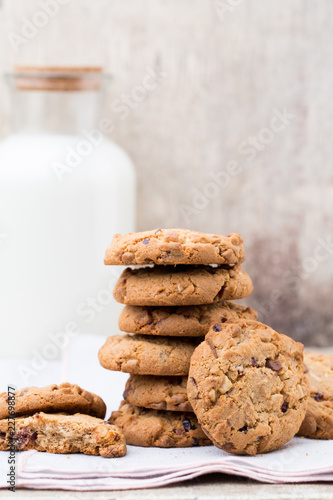 Sticker Chocolate oatmeal chip cookies with milk on the rustic wooden table.