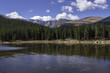 A fall  view of a calm alpine lake with Mt. Evans in the background.