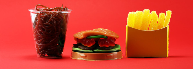 candies with jelly and sugar. colorful array of different childs sweets and treats. candy burger, fries and soft drink. © beats_