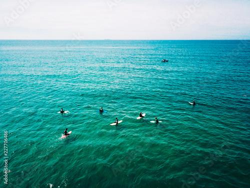 Leinwanddruck Bild surfer waiting on beach for the next big wave in porto, portugal