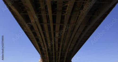 Fototapeta Tilt shot of the Margaret Bridge at the Margaret Island in Budapest, view from under the bridge.