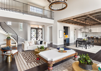 Stunning living room interior panorama showing entry, dining room, and kitchen of home with open concept floor plan