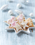 Christmas butter cookies with icing and sugar pearls. Bright wooden background. Close up. - 227738627
