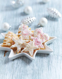 Christmas butter cookies with icing and sugar pearls. Bright wooden background. Close up. - 227738825