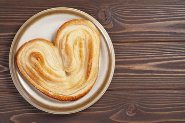 Puff pastry cookie in shape of ear