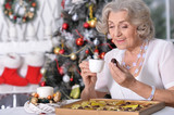 woman with  chocolates and  cup of tea  - 227769236