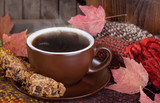 Closeup of a Cup of Steaming Coffee and Raisin Cookies