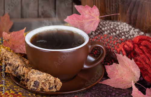 Wall mural Closeup of a Cup of Steaming Coffee and Raisin Cookies