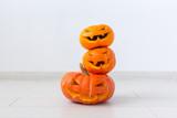 Halloween pumpkins. Funny Jack O'Lantern on the light room - 227771694