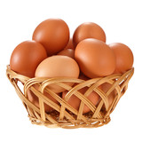 Eggs in a wicker basket. Isolated on white background. - 227773028