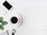 top view of office desk workspace with coffee cup, notebook, plastic plant, smartphone and keyboard on white background, graphic designer, Creative Designer concept.