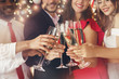 Champagne glasses in people hands at New Year - 227783282