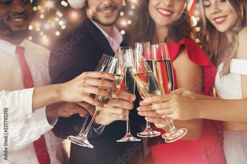 Champagne glasses in people hands at New Year