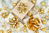 Golden gifts or presents boxes, snowy fir tree and christmas decorations on white table top view. Flat lay.